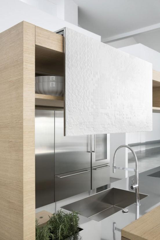 Кухня Archea. Кухонная мойка является частью столешницы из нержавейки.